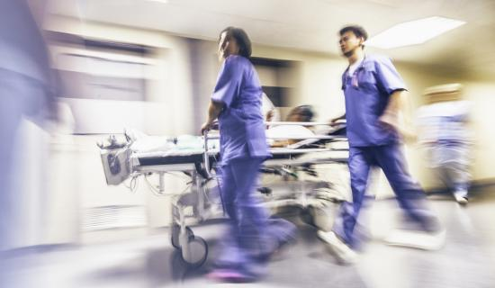 nurses running with stretcher
