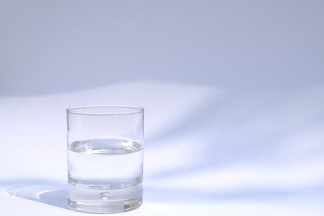 small glass of water in sunlight