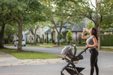 Woman running pushing a baby in stroller