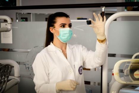 Medical woman inside of lab wearing mask